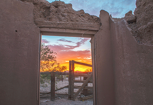 Adobe archway facing sunset in Florence, AZ (image)